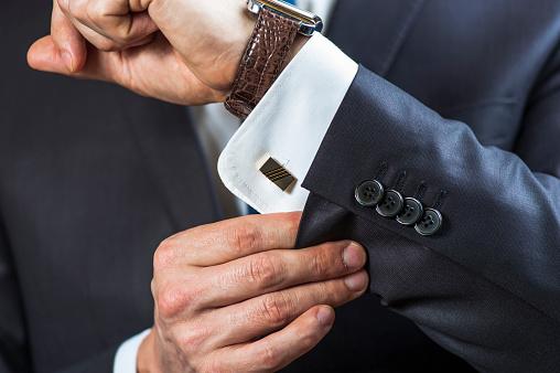 istock Businessman correcting shirt sleeve 515836814
