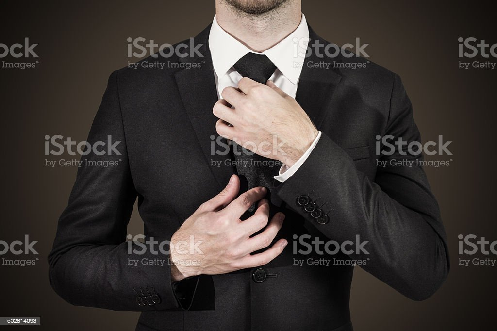 businessman correcting tie fashion stock photo