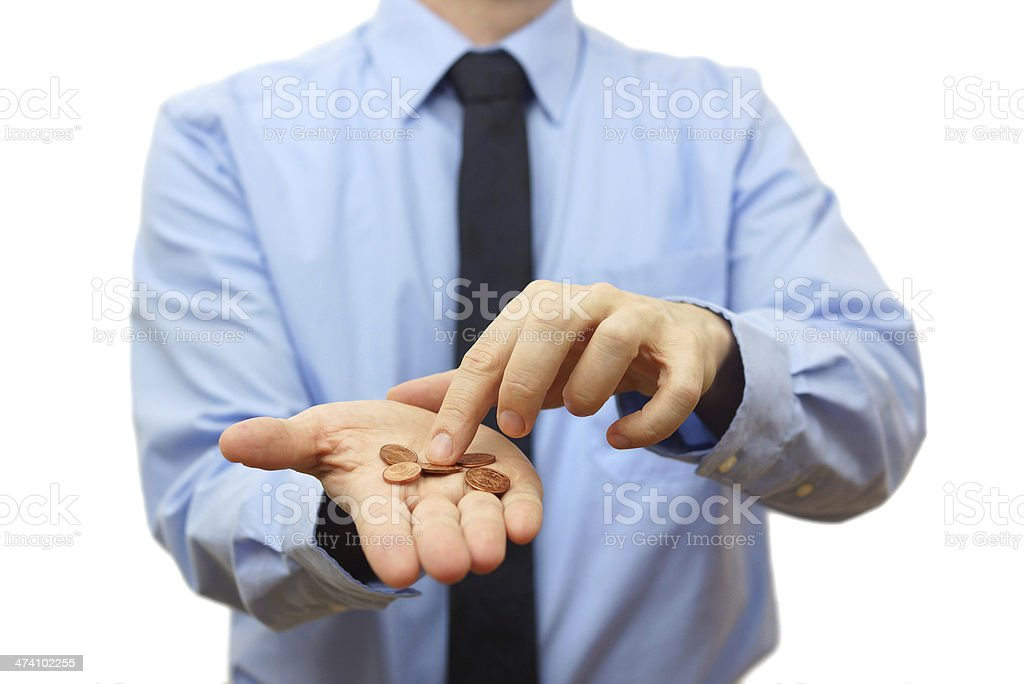 businessman counting coins on hand. Crisis concept stock photo