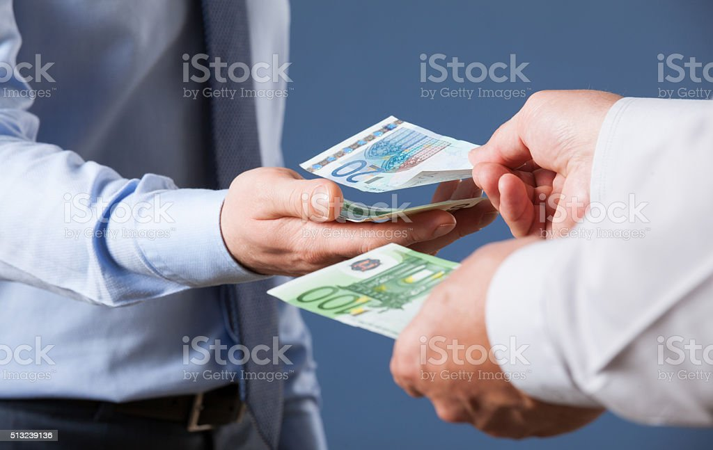 Businessman counting euro banknotes stock photo