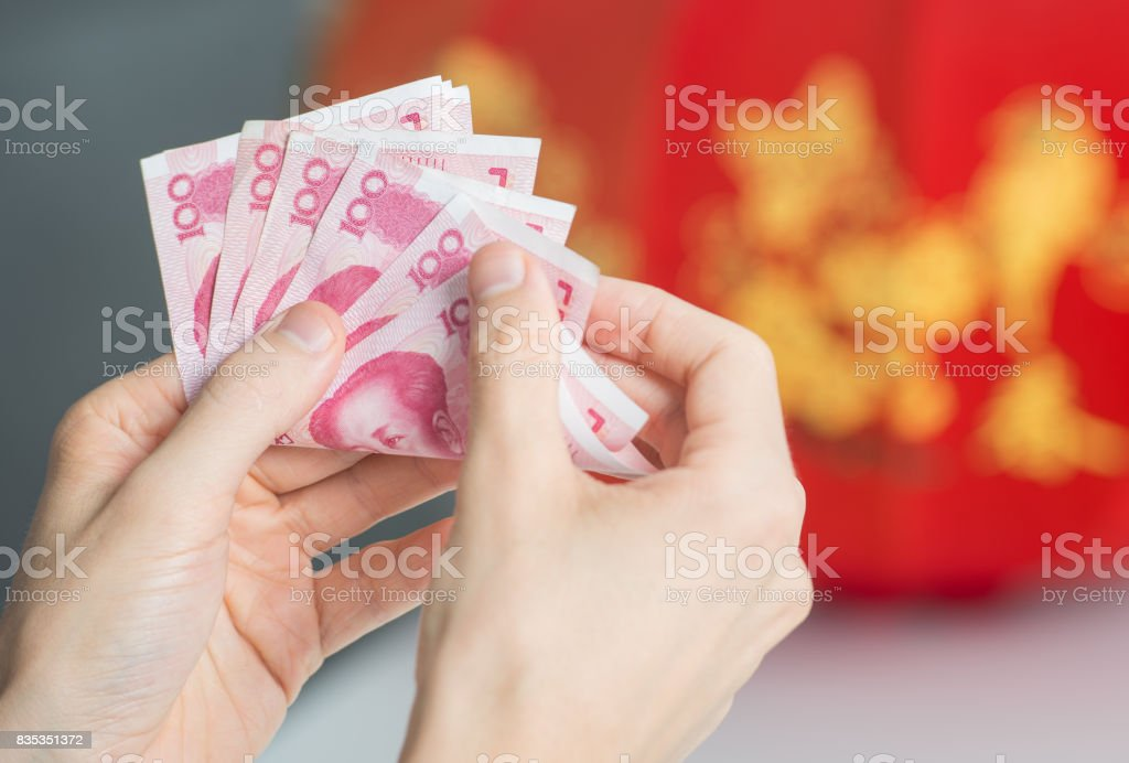 Businessman counting money in hands stock photo