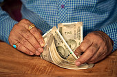 istock A Businessman Counting Money On A Table 1172759904