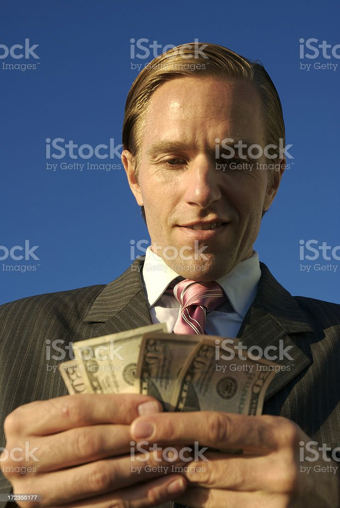 Businessman Counts Cash Dollars Blue Sky royalty-free stock photo