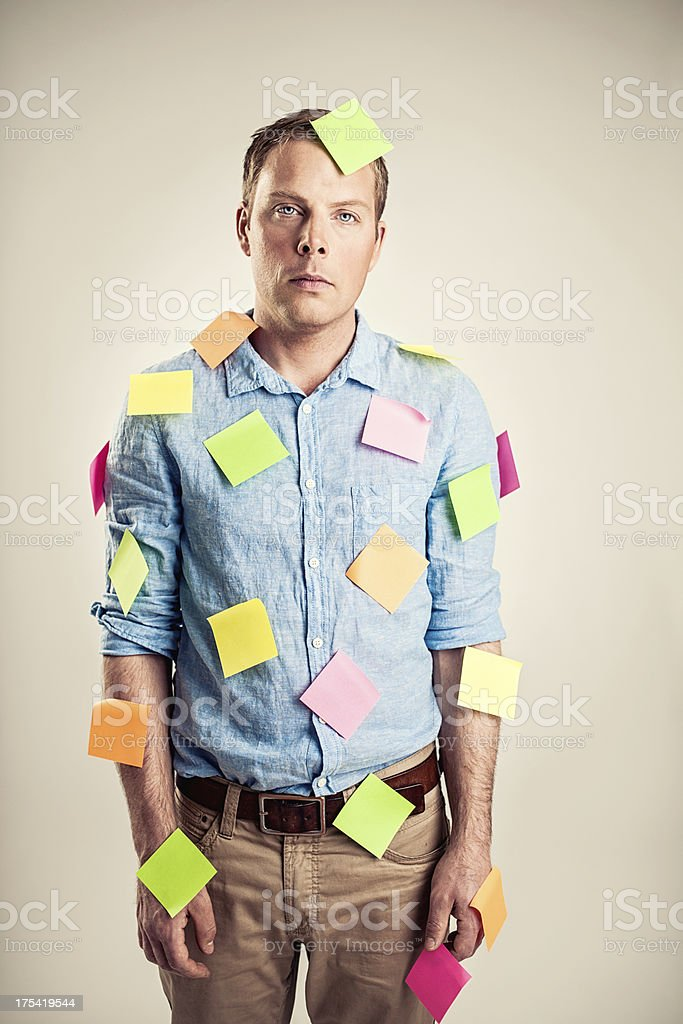 Businessman covered in notes stock photo