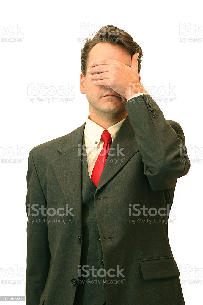 Businessman covering eyes royalty-free stock photo