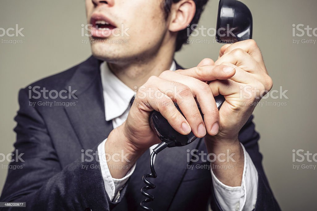 Businessman covering the phone stock photo