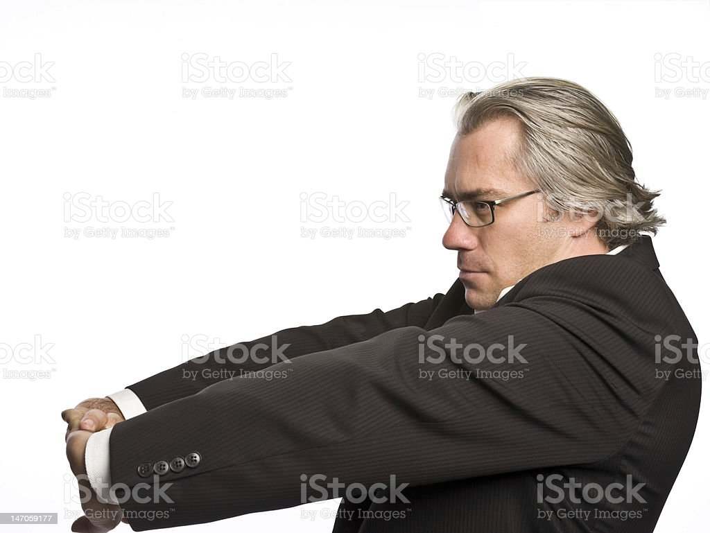 Businessman cracking knuckles stock photo