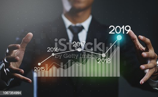 istock Businessman Creating Growing Statistic Financial Graph 2019 1067354994
