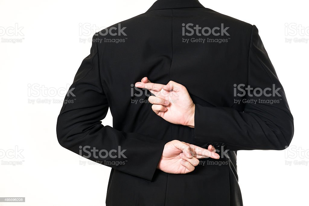 Businessman cross his finger on white background stock photo