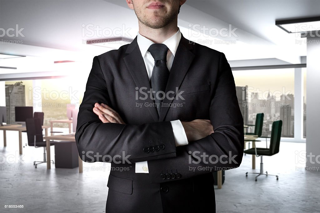 businessman crossed arms in modern office stock photo