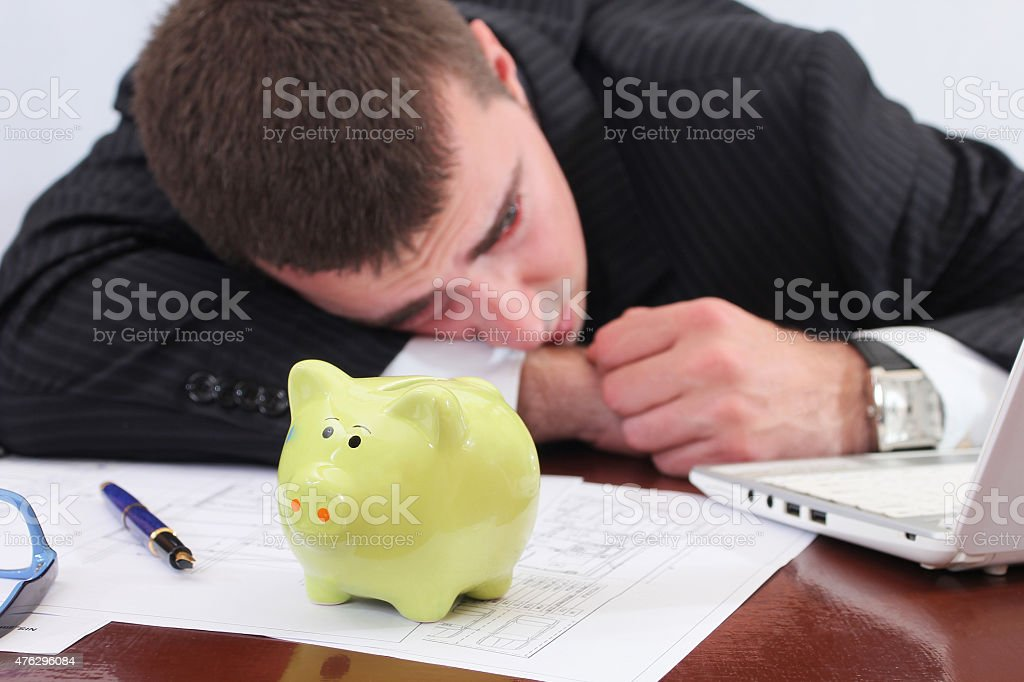 Businessman crying because of financial problems stock photo