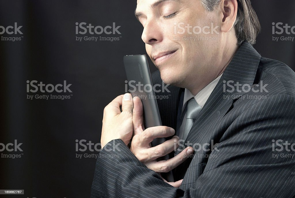 Businessman Cuddles Tablet royalty-free stock photo