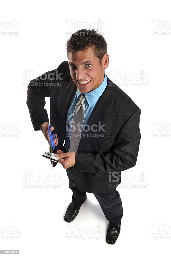 Businessman cutting credit card royalty-free stock photo