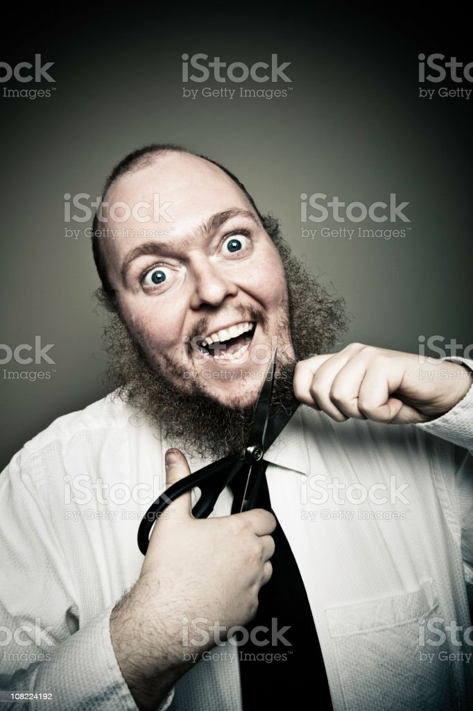 Businessman Cutting Off Beard with Scissors royalty-free stock photo