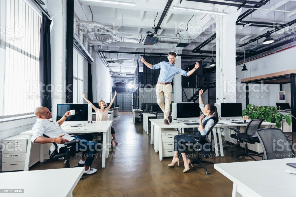 businessman dancing on table stock photo
