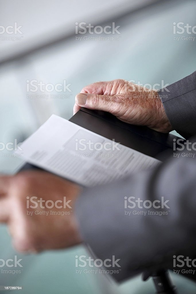 Businessman delivering presentation at conference royalty-free stock photo
