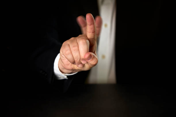 businessman denying with his finger stock photo