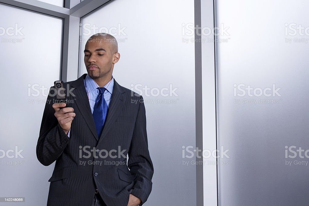 Businessman dialing a number on his cell phone royalty-free stock photo