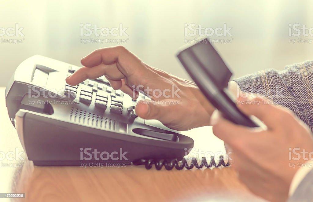 businessman dialing phone stock photo