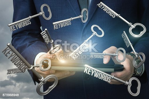 866680594 istock photo Businessman dials the keywords on tablet. 875968948
