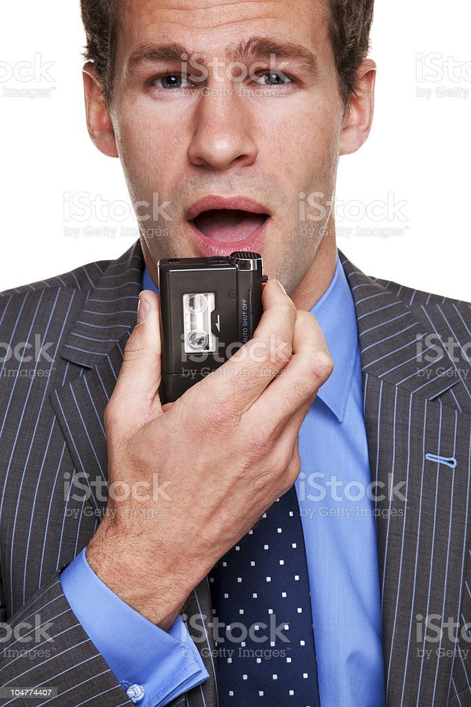 Businessman dictating notes stock photo