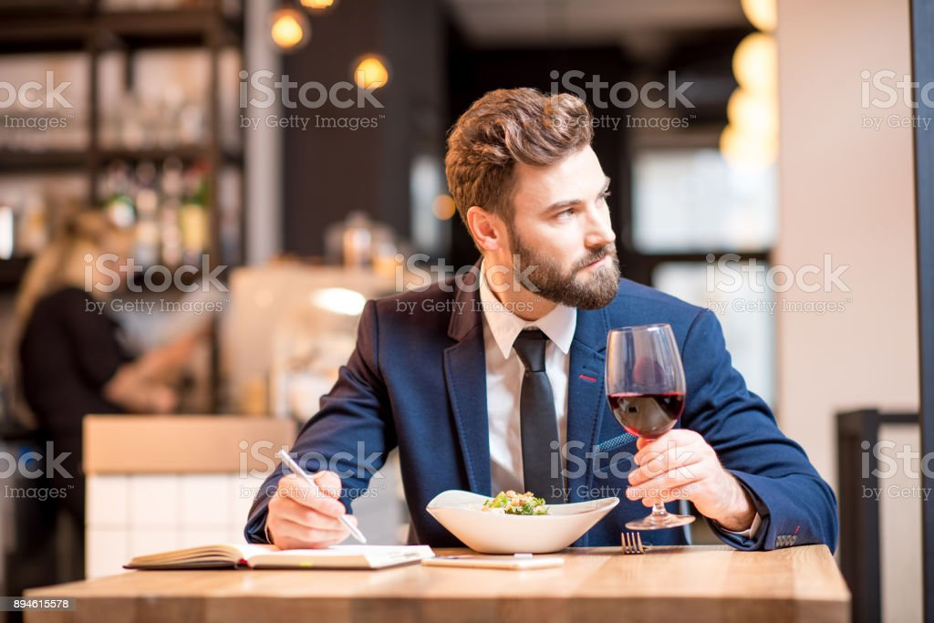 Businessman dinning at the restaurant royalty-free stock photo