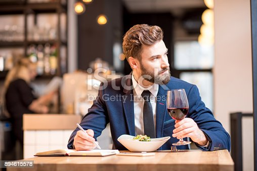 istock Businessman dinning at the restaurant 894615578
