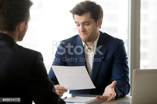 istock Businessman disappointed with partners offer 845314170