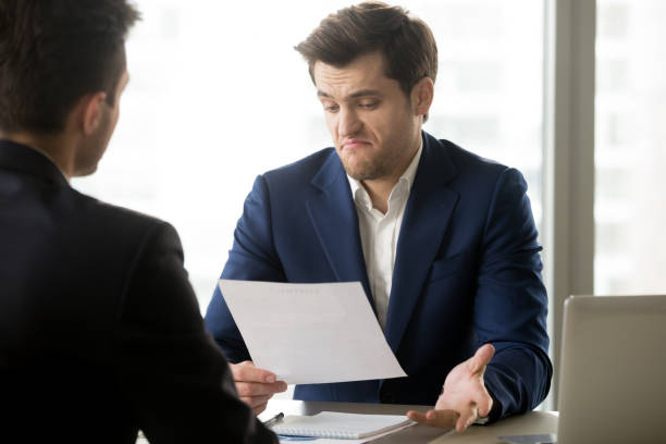 Businessman disappointed with partners offer stock photo