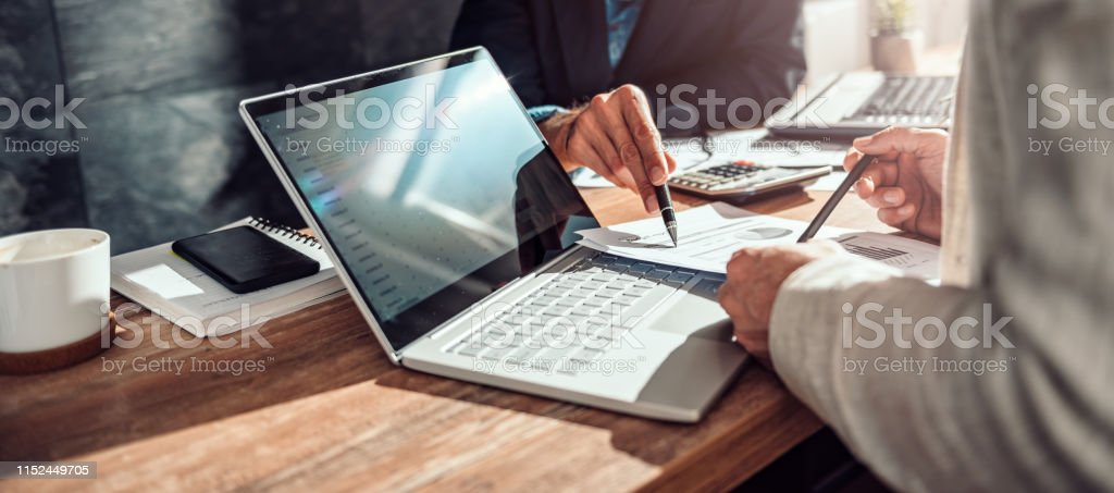 Businessman discussing budget report Businessman discussing budget report at the meeting Adult Stock Photo