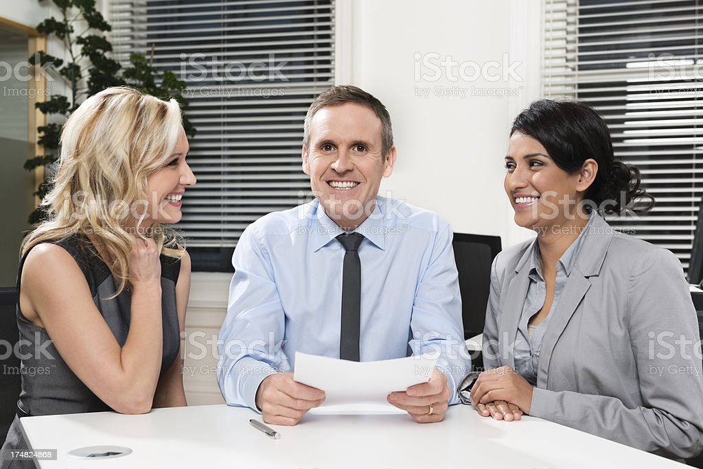 Businessman Discussing Project With Colleagues royalty-free stock photo
