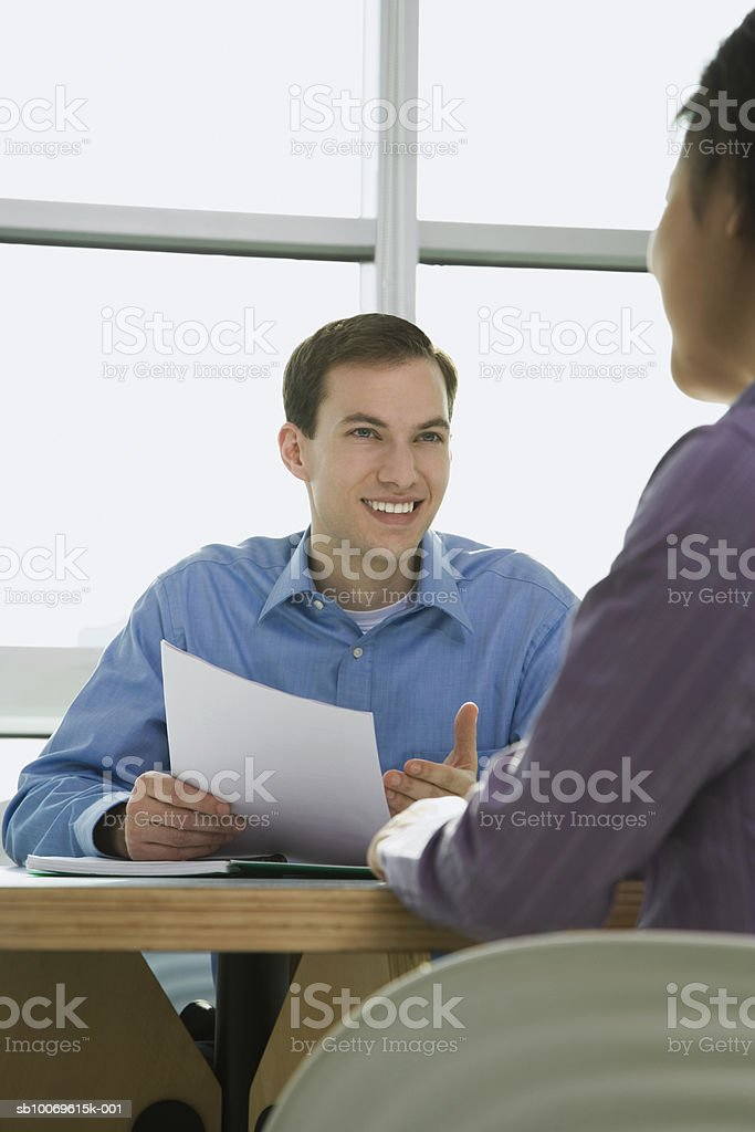 Businessman discussing with woman royalty free stockfoto