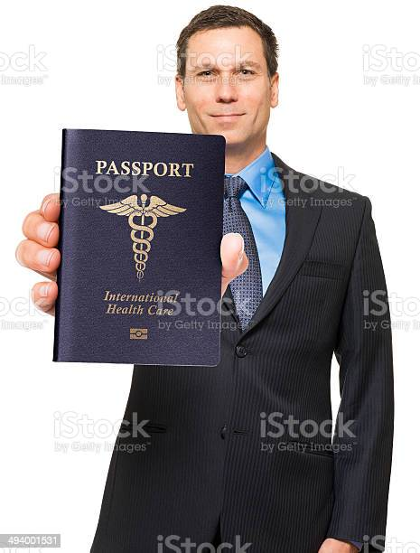 Businessman doctor with medical tourism passport isolated on white picture id494001531?b=1&k=6&m=494001531&s=612x612&h=mt1tpayfcpubca qjxb5ot5leyyy12xuheh1zzdn8ku=