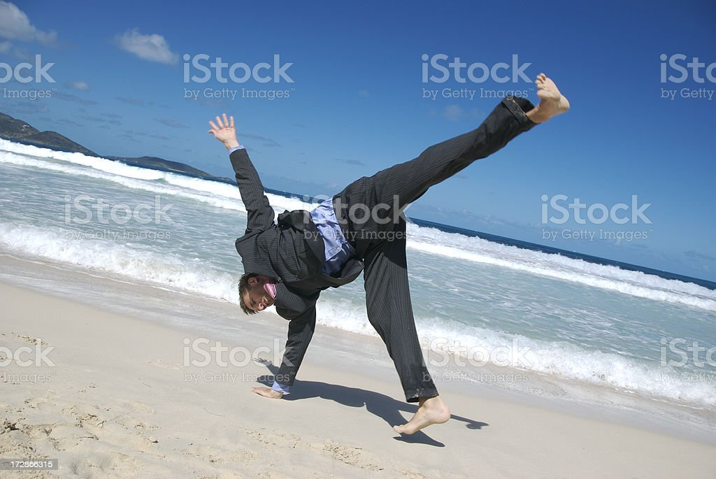 Businessman Does Cartwheel on the Beach royalty-free stock photo