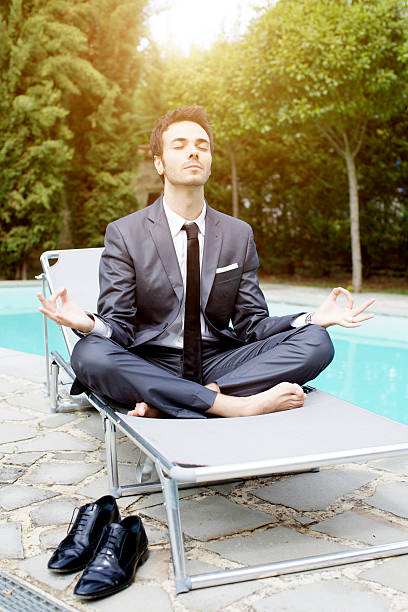 Businessman does yoga stock photo