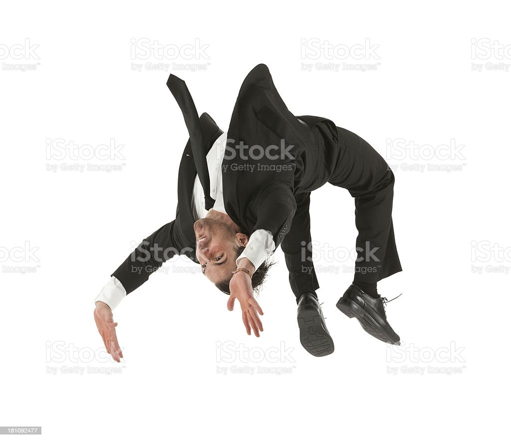 Businessman doing backflip stock photo