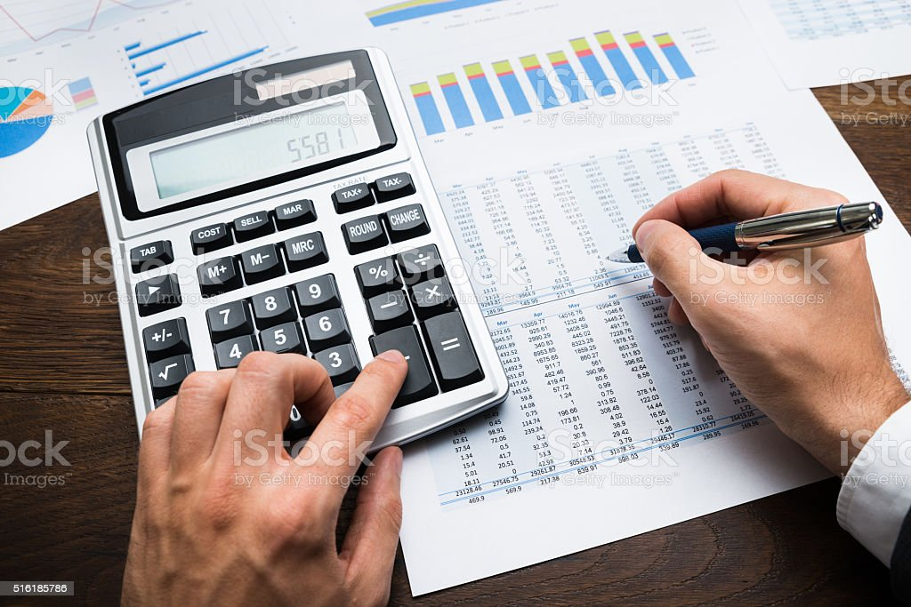 Businessman Doing Financial Calculations stock photo