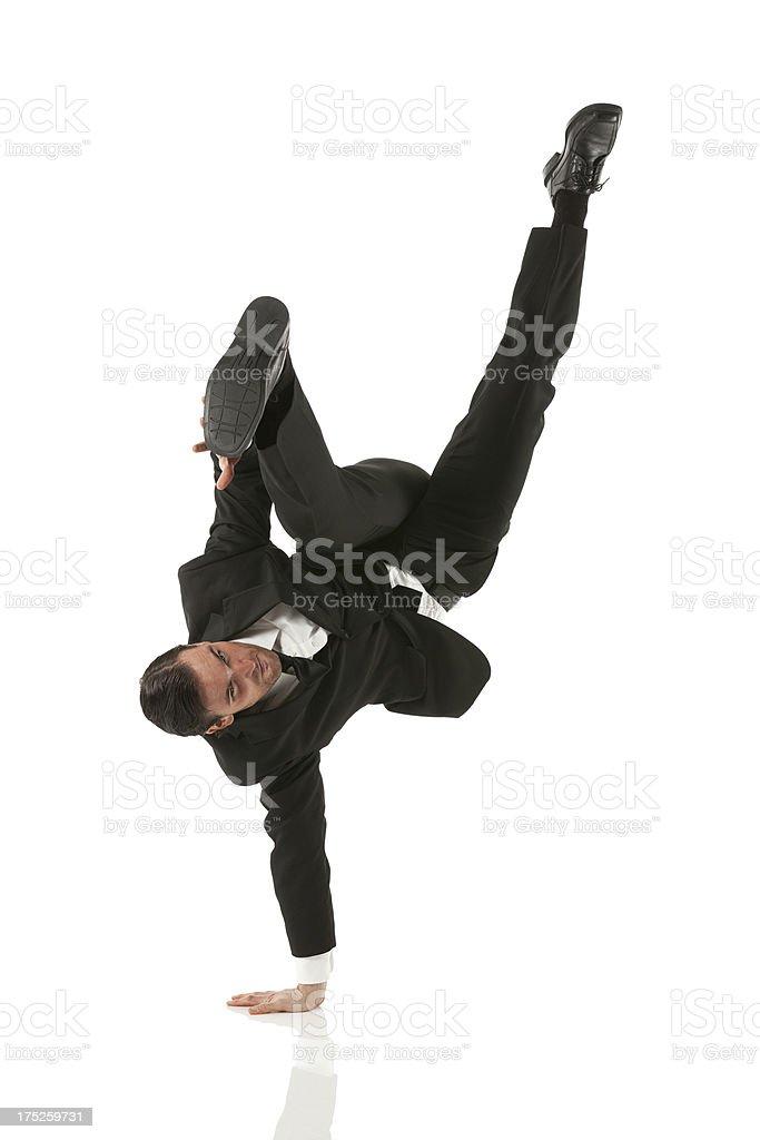 Businessman doing handstand stock photo
