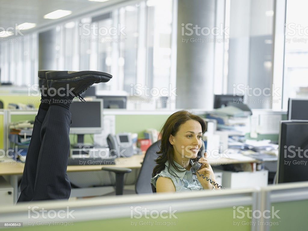 Businessman doing headstand in office royalty-free stock photo
