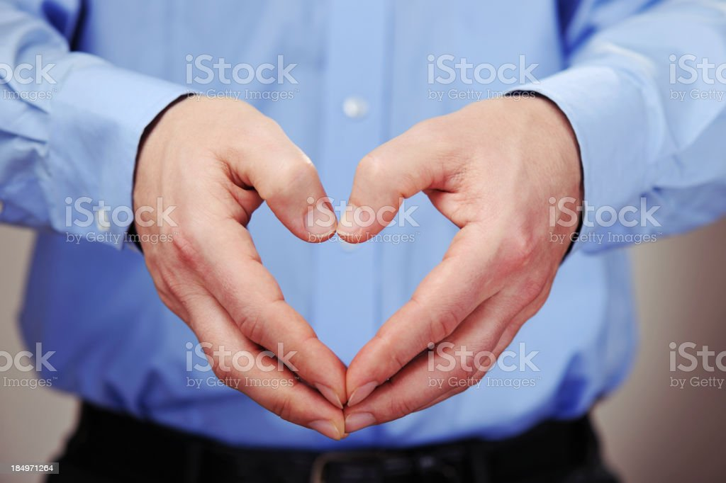 Businessman doing heart shape with his hands royalty-free stock photo