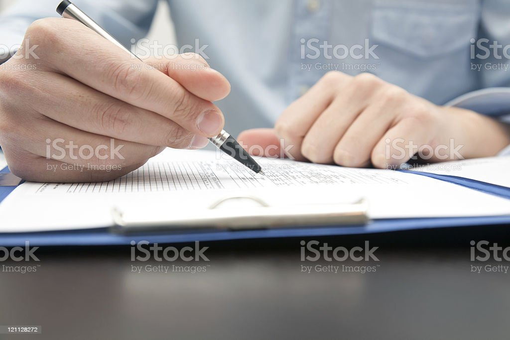 Businessman doing some paperwork in his office royalty-free stock photo