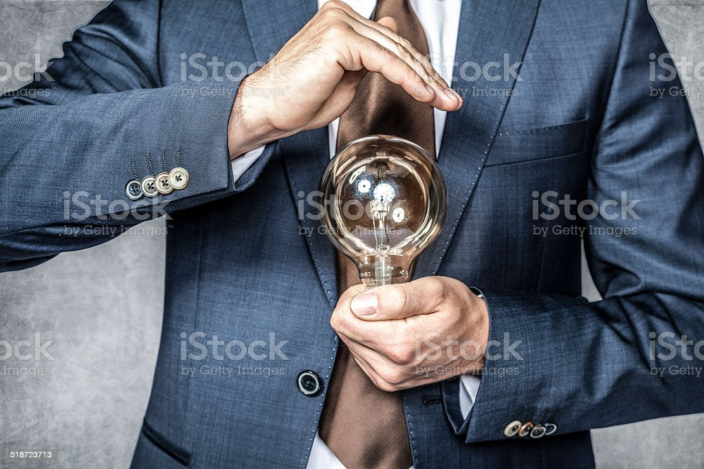 businessman doing to save energy stock photo