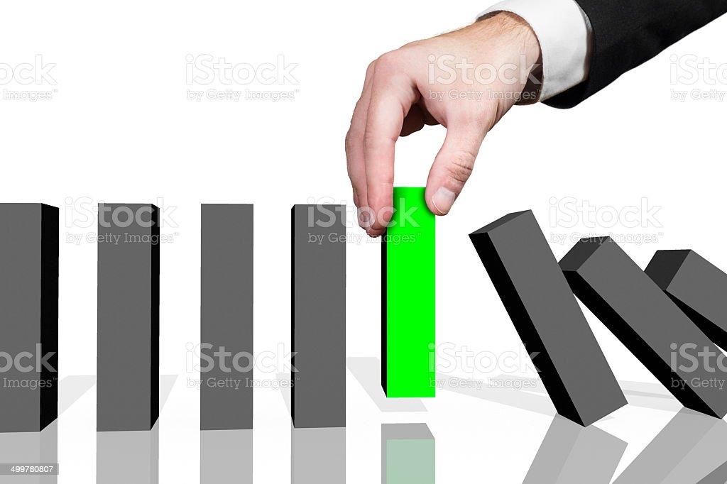 businessman domino row green stock photo