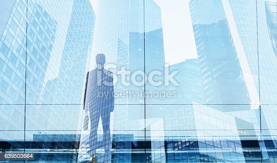 994786356 istock photo businessman double exposure, career opportunity or business success 639503664