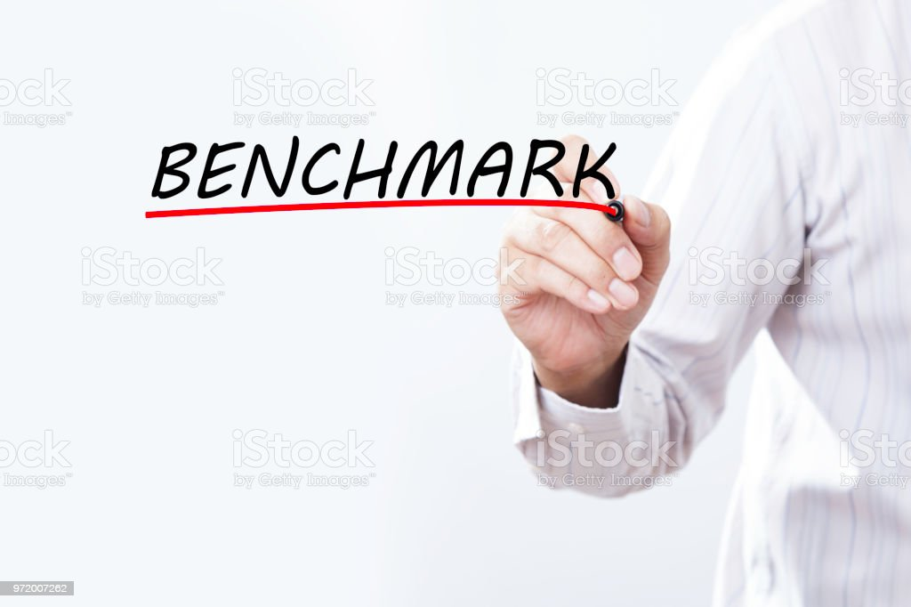 Businessman draw benchmark word, Training Planning Learning Coaching Business Guide Instructor Leader concept. stock photo