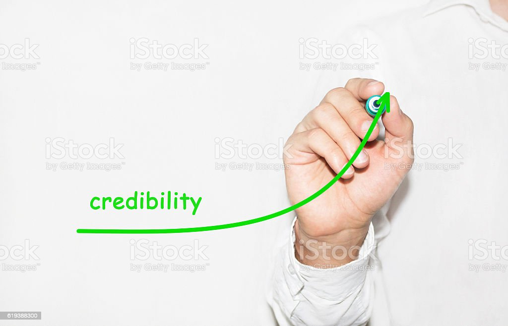 Businessman draw growing graph symbolize growing credibility stock photo