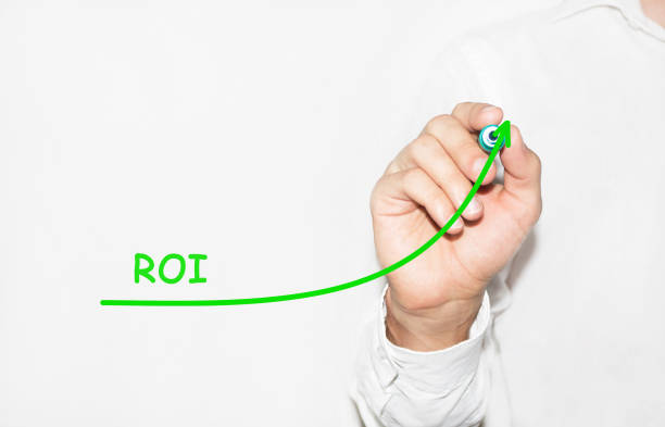 Businessman draw growing graph symbolize growing ROI Return On Investment stock photo