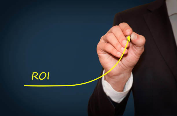 Businessman draw growing line symbolize growing ROI Return on Investment stock photo