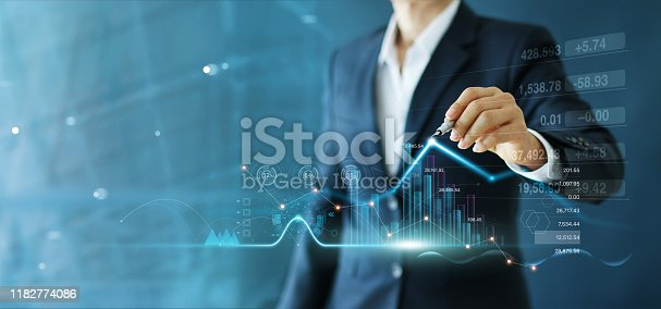 istock Businessman draw growth graph and progress of business and analyzing financial and investment data ,business planning and strategy on blue background. 1182774086