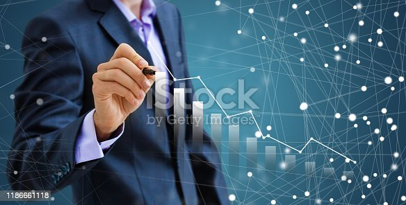 509469434istockphoto Businessman draw growth graph and progress of business and analyzing financial and investment data ,business planning and strategy on blue background. 1186661118